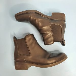 Black ankle booties by Browns